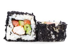 Japan square black tobiko rolls with shrimp, salmon and cucumber Stock Image