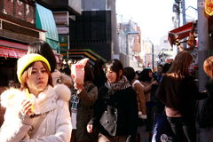 Japan street-harajuku. HARAJUKU TOKYO JAPAN-JANUARY 20: Friends going to shopping malls japan walk street playfully in January 20, 2013 Stock Image