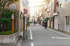 Japan street in the morning with few people use bicycle and walk Royalty Free Stock Photo