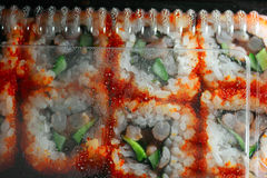 Japan sushi in packaging box top view, drops of water on inner side  plastic cover Royalty Free Stock Image