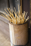 Japan Takayama Skewers for Japanese dumplings (Dango) in wooden bucket Royalty Free Stock Photos