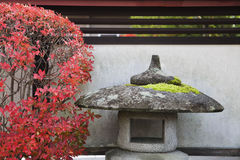 Japan Takayama Stone Lantern and bush in Autumn colors Royalty Free Stock Images