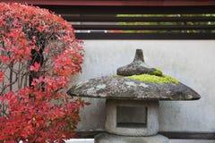 Japan Takayama Stone Lantern and bush in Autumn colors Royalty Free Stock Images