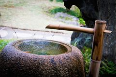 Japan Temple stone water basin. Stock Photography