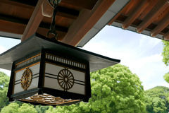 Japan temple wooden lamp with sky and green tree Royalty Free Stock Photo