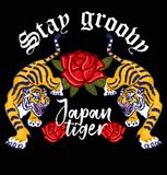 Japan Tiger. Embroidery angry wild tigers with decorative flowers Japan Tokyo concept Japanese hieroglyphs and lettering `Stay groovy`. Modern mascot Royalty Free Stock Photos