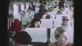 Shinkansen Bullet Train. JAPAN, TOKYO, APRIL 1980. Two Shot Sequence Of A JNR Class 961 Shinkansen Bullet Train Leaving Tokyo Station And Passengers Inside The stock video footage