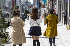 Japan, Tokyo, 04/12/2017. A company of girls walks along the streets of a big city royalty free stock photos