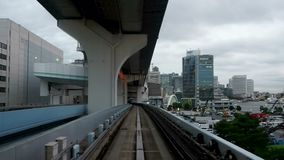 Japan, Tokyo, New Transit Yurikamome line, formally called the New Tokyo Waterfront Transit Line, accelerated video footage of the stock video