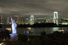 Japan, Tokyo, night view of the bay with its bridge and Statue of Liberty Royalty Free Stock Photo