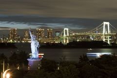 Japan, Tokyo, night view of the bay with its bridge and Statue of Liberty Royalty Free Stock Photography