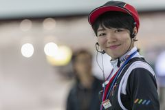 Japan, Tokyo, 04/08/2017. Smiling girl at the auto show royalty free stock photography