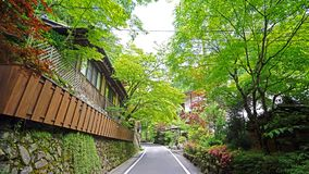 Japan traditional building, zen garden, village footpath, green plants. The Japan traditional building, zen garden, village footpath, green plants and trees stock photography