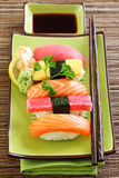 Japan traditional food sushi. On green plate Royalty Free Stock Photography