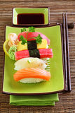 Japan traditional food sushi. On green plate Royalty Free Stock Images
