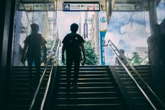 Japan man walking out of train station stock images