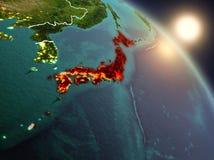 Japan van ruimte tijdens zonsopgang Stock Afbeeldingen