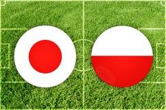 Japan vs den Polen fotbollsmatchen Arkivfoto
