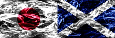 Japan vs Scotland, Scottish smoke flags placed side by side. stock images