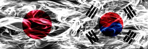 Japan vs South Korea, Korean smoke flags placed side by side. royalty free stock photography