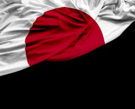 Japan waving flag on black background Stock Images