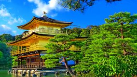 Japan zen golden temple. Place in front lake and garden stock photography