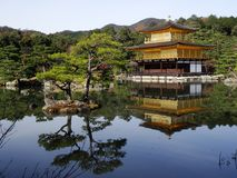 Japan zen golden temple. Place in front lake and garden royalty free stock photography