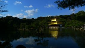 Japan zen golden temple. Place in front lake and garden stock image