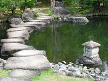 Japan zen path. In a garden, pond surrounded Stock Photography