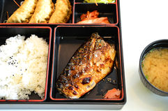 Japanease food box. Bento with grill saba fish and miso soup isolate on white background Stock Images