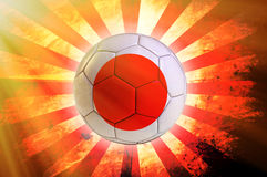 Japanes ball. Soccer ball with Japanes flag as the background Stock Photo