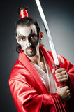 Japanese actor with sword. On black Stock Image