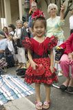 Japanese American girl is in bright red Mexican dress at annual Old Spanish Days Fiesta held every August in Santa Barbara, Califo Stock Photos