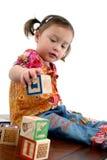 Japanese American Preschooler. Beautiful three year old Japanese American preschooler with alphabet blocks stock photo
