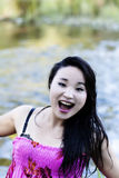 Japanese American Woman Open Mouth Smile At River Stock Photo