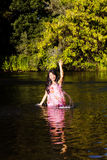 Japanese American Woman In River Splashing Water Stock Photography