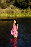 Japanese American Woman Standing In River Wearing Dress Royalty Free Stock Photo