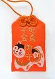 Japanese amulet. Red Japanese amulet for fertility Stock Image