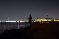 A Japanese angler and the night sea. In Osaka royalty free stock photos