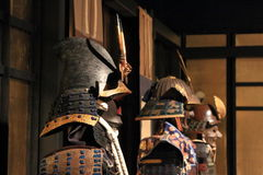 Japanese samurai armour. Three sets of samurai armor are arranged in a row. In the foreground is visible armor with eboshi style helmet kabuto with an iron plate Royalty Free Stock Image