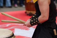 Japanese artist playing on traditional taiko drums Royalty Free Stock Photo