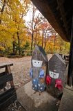 Japanese Autumn display of boy and girl wooden dolls Royalty Free Stock Photos