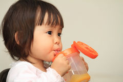 Japanese baby girl drinking water. (1 year old stock photos
