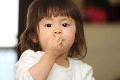 Japanese baby girl eating cereal Stock Photos
