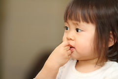 Japanese baby girl eating cereal Royalty Free Stock Images