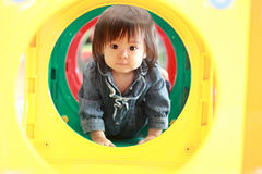 Japanese baby girl passing through a tunnel Royalty Free Stock Image
