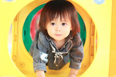 Japanese baby girl passing through a tunnel Stock Images