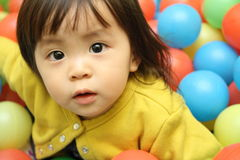 Japanese baby girl playing in ball pool Stock Photo