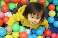 Japanese baby girl playing in ball pool Stock Photos
