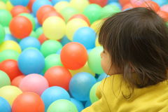 Japanese baby girl playing in ball pool Royalty Free Stock Image